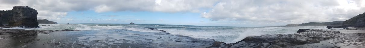 Wild wild west white wash waves panoramic. Waves crashing on rocks panoramic Stock Image