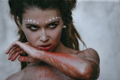 Wild woman. Lamorous photos of wild woman showing blood and gore dripping from the mouth Stock Image