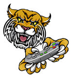 Wildcat Bobcat Player Gamer Mascot. A wildcat or bobcat video game player online sports gamer animal mascot holding a controller Royalty Free Stock Image