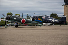 Wildcat and Zero. A Japanese Zero and F4F Wildcat belonging to the Commemorative Air Force sits on the runway at dawn during the Redding Airshow Royalty Free Stock Images