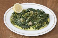 Wilde greens met citroen Royalty-vrije Stock Afbeeldingen