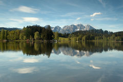 Wilder Kaiser mountain range reflected in a mountain lake Royalty Free Stock Images