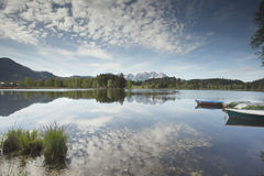 Wilder Kaiser mountain range reflected in a mountain lake Stock Photo