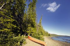 Wilderness beach and boat Stock Images