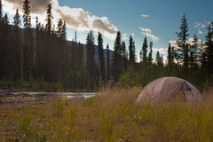 Wilderness Camping Concept. Tent on bank of Big Salmon River, Yukon Territory, Canada Stock Photo