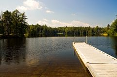 Wilderness Dock and Boat Ramp. Small boat dock and boat ramp on a picturesque wilderness pond in Maine stock photo