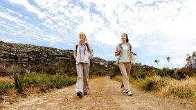Wilderness explorers. Two girls walking outdoors and having fun exploring the wilderness stock photography