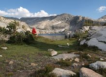 Wilderness Hiker. A hiker overlooks 10,568' Three Island Lake in the John Muir Wilderness of the Sierra National Forest Royalty Free Stock Photography