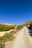 Wilderness on the island of Crete. Dirt track winding through the wilderness on the island of Crete Stock Image