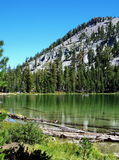 Wilderness Lake. Cliff Lake, driftwood and scenic ridge at Lassen Volcanic National Park Stock Images