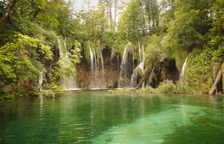 Wilderness landscape with beautiful waterfalls Royalty Free Stock Images