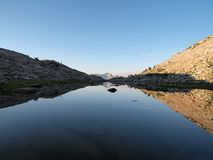 Wilderness Pond and Peak. 12,195 foot Mt. Henry reflected in a high alpine pond in the John Muir Wilderness of the Sierra National Forest Royalty Free Stock Images