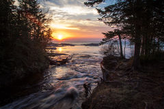 Wilderness River Sunset. The Hurricane River as it empties into Lake Superior at sunset. Pictured Rocks National Lakeshore. Munising, Michigan stock images
