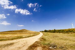 Wilderness road. In late autumn, through the prairie wilderness road Royalty Free Stock Photo