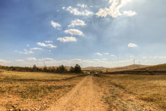 Wilderness road. In late autumn, through the prairie wilderness road royalty free stock images