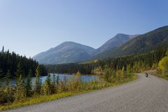 Wilderness View of Motorbike Riding the Remote Cassiar Highway, Royalty Free Stock Images