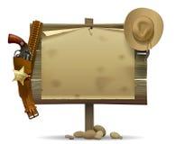 Wildes hölzernes Westschild mit einer Blatt- und Cowboyzubehör-ISO stockbilder