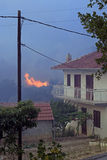 Wildfire close to house Stock Photo