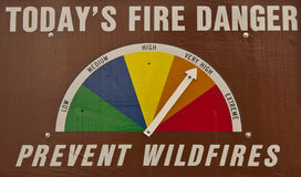 Wildfire danger. Public information on a wildfire danger notice board with an arrow pointing to very high danger stock images
