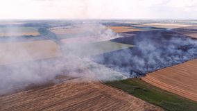 Wildfire danger burning agricultural field smoke. Wildfire danger. Burning agricultural field smoke. Countryside landscape stock footage