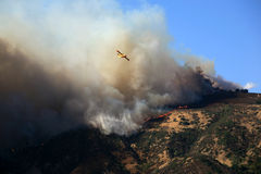 Wildfire-fighting Plane. Planes flying over CA wildfire, October 13, 2008 to drop water and fight the rapidly spreading fire near Los Angeles Stock Photos