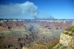 Wildfire at Grand Canyon. Panoramic view of the North Rim of the Grand Canyon with smoke visible from a wildfire Royalty Free Stock Photos