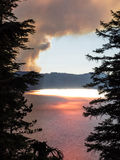 Wildfire near Crater Lake in Oregon. A wildfire starts to create a plume of smoke in the mountains of the Cascade Range in Oregon near Crater Lake National Park Royalty Free Stock Photo