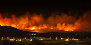Wildfire in Nevada desert, on Red Rock Road. Wildfire burning at night in Nevada desert on Red Rock Road near Reno royalty free stock image