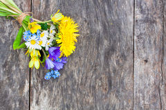 Wildflower bouquet on the oak brown table Royalty Free Stock Image