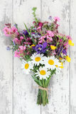 Wildflower Posy. Wild flower posy over distressed wooden background Stock Photo