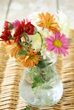 Wildflowers. Wild flowers in a vase on a wooden table stock images