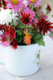 Wildflowers. Wild flowers in a vase on a wooden table stock photos