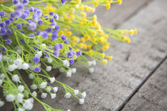 Wildflowers on the background of wood Stock Photo