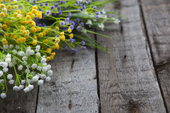 Wildflowers on the background of wood. Royalty Free Stock Photo