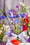 Wildflowers in bottles Stock Photo