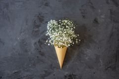 Wildflowers in the cone top view or flat lay on black background royalty free stock images