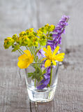 Wildflowers in glass vase Stock Photos