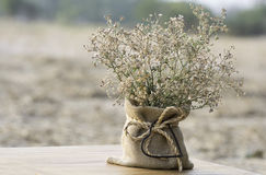 Wildflowers in a vase  sackcloth and metal heart shape  on blurr Royalty Free Stock Photos