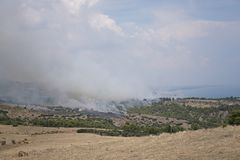 Wildland fire on the mountains stock photography