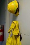Wildland Firefighting Gear Hanging on Wall Stock Image