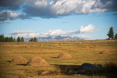 Wildlife Altai. The stack of hay, mountains and sky with clouds Stock Images