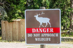 Wildlife Danger Sign. Brown, white, and red sign to warn of the danger of approaching wildlife Royalty Free Stock Photo