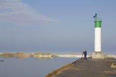Wildlife photographer at Grand Bend lighthouse on Lake Huron stock image