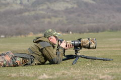 Wildlife photographer outdoor in action Stock Image