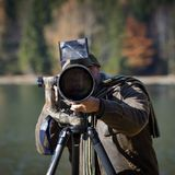 Wildlife photographer outdoor in action Stock Photo