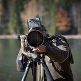 Wildlife photographer outdoor in action Stock Photo