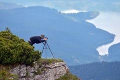 Wildlife photographer outdoor in autumn Stock Image