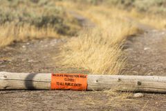 Wildlife protection area sign on log in the Tetons Royalty Free Stock Photo