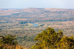 Wildlife Terrain Valley River. Overlooking the valley and white imfolozi river with the long grass vegetation in the Imfolozi wildlife animal game reserve in Stock Image