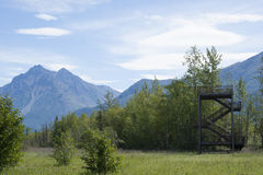 Wildlife Viewing Tower Reflections Lake Alaska. Steel 40 foot Wildlife Viewing Tower with Pioneer Peak background at Palmer Hay Flats State Game Refuge Royalty Free Stock Photography